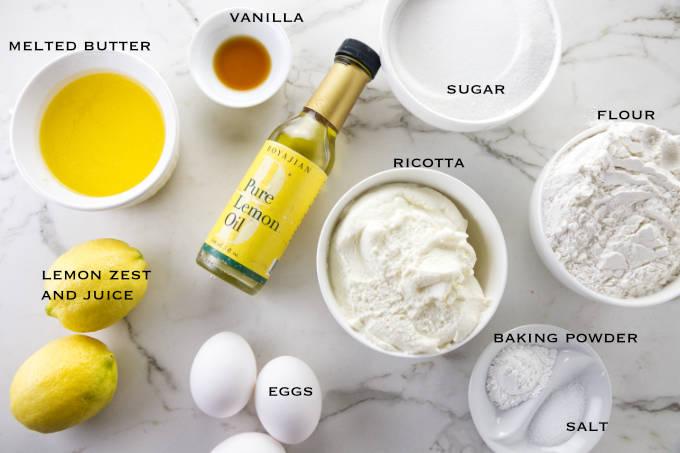 Ingredients needed to make lemon ricotta cake.