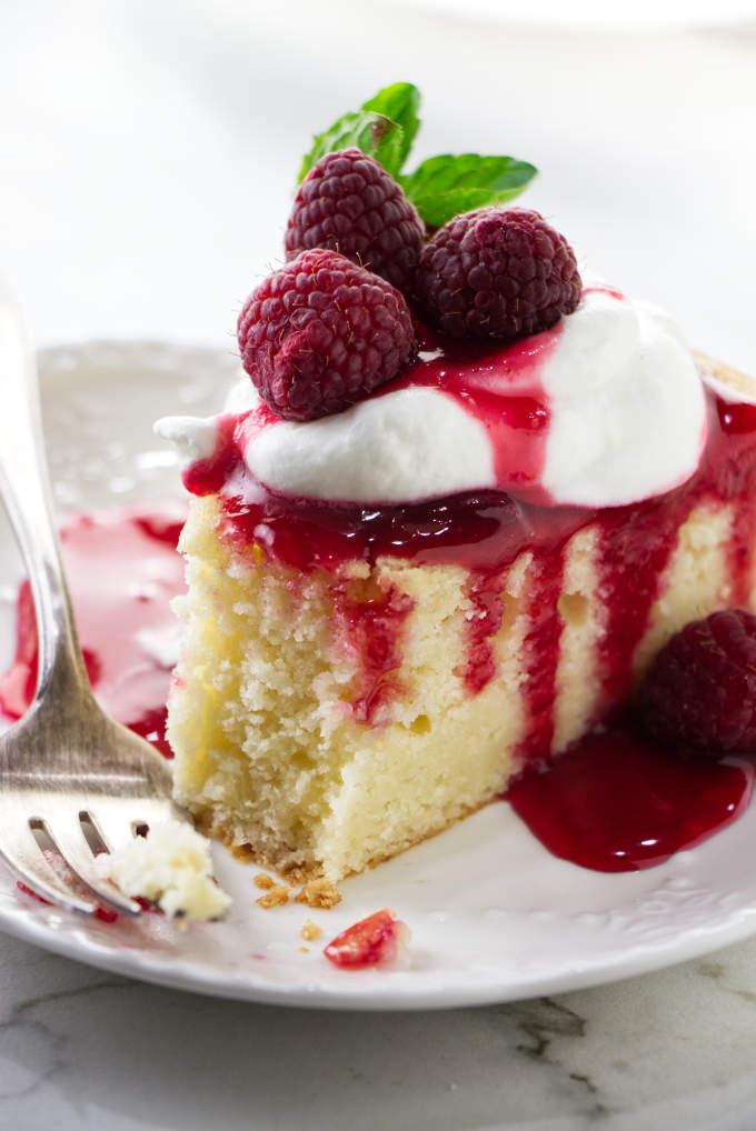 A fork next to a slice of lemon ricotta cake.