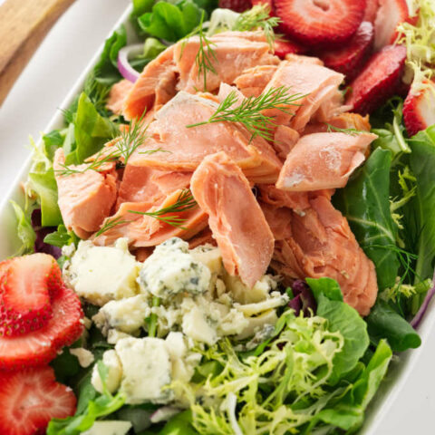 Overhead view of a bowl of Salmon Salad with Strawberries
