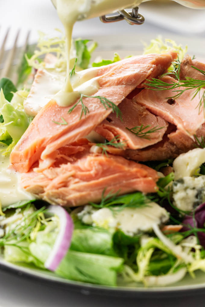 Close up view of a serving of Salmon Salad and vinaigrette