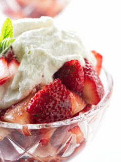 A dish of marsala strawberries with sweetened ricotta on top.