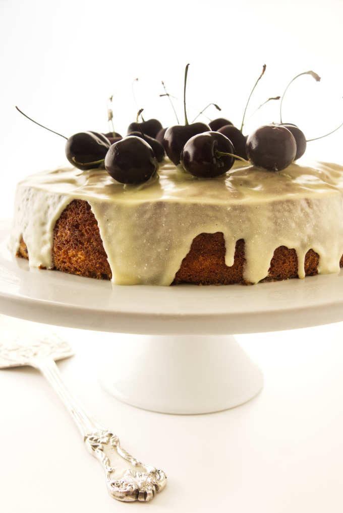 Fresh cherry cake with a drizzle of white chocolate ganache