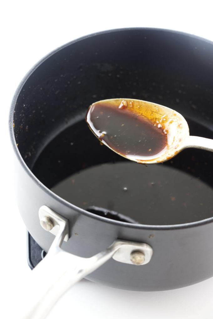 Reducing the honey bourbon marinade for a glaze.