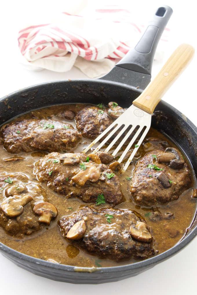 Skillet with salisbury steak in mushroom sauce