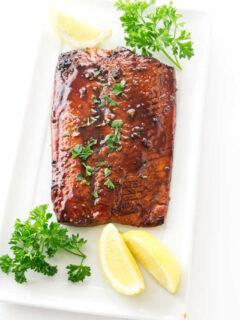 Bourbon glazed salmon on a serving platter.