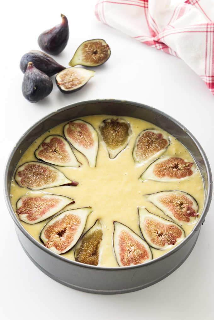 Overhead view of figs on cake batter