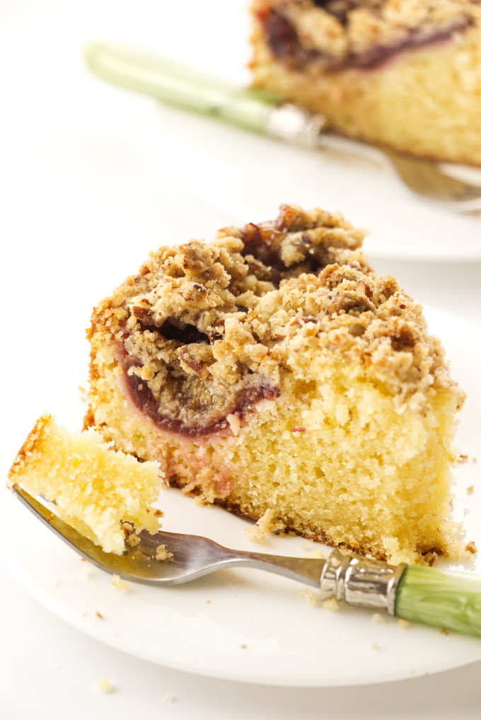 Close up view of a slice of fig cake and a bite on a fork