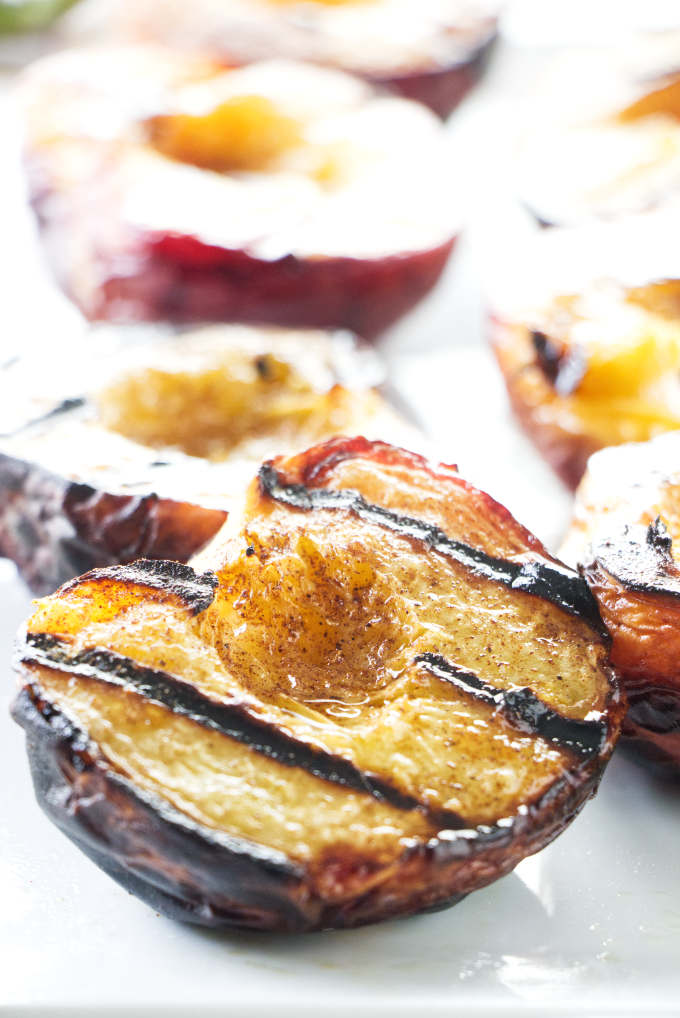 A platter of warm grilled peaches.