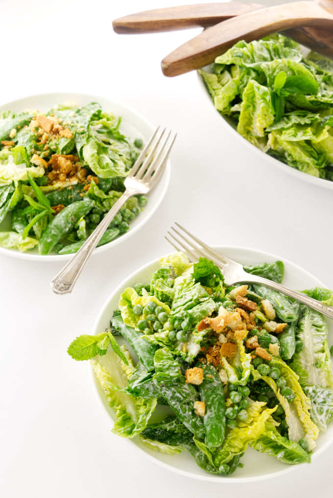 Two servings of salad and a salad bowl