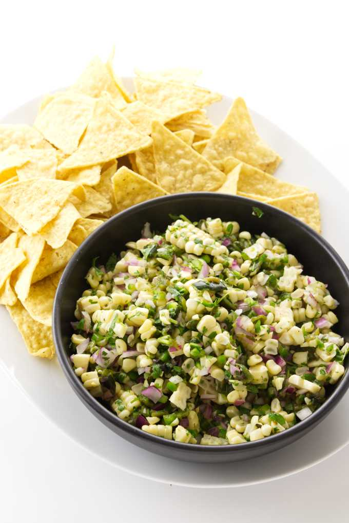 close up view of chipotle corn salsa and corn tortilla chips
