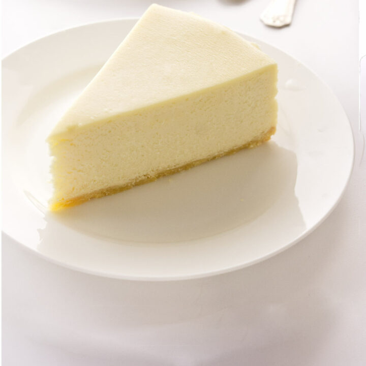 a serving of cheesecake on a dessert plate