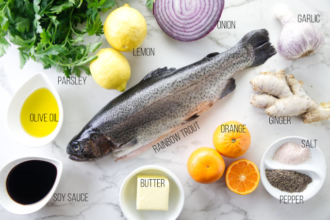 Ingredients needed for a baked rainbow trout recipe.