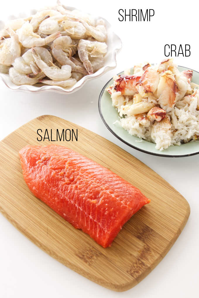 Crab, shrimp, and salmon ingredients for seafood mac n cheese.