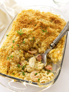 A 13 x 9 baking dish with baked seafood mac and cheese.