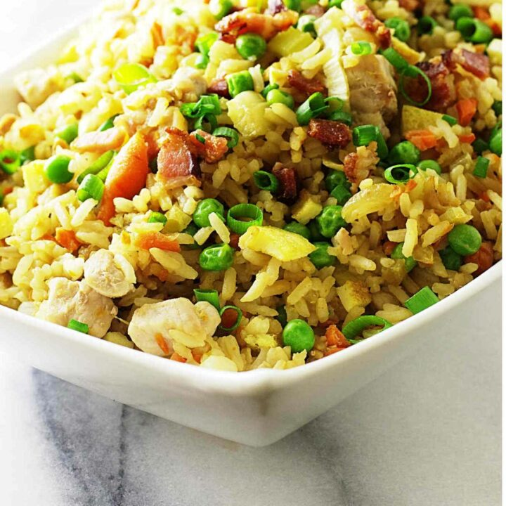 A dish of pork fried rice with leftover pork chops.