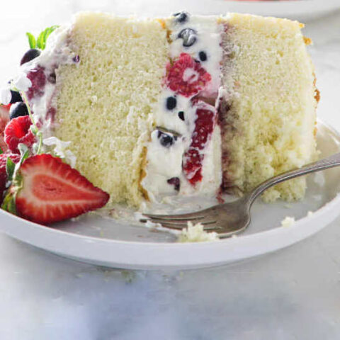 A slice of hot milk sponge cake on a serving plate.