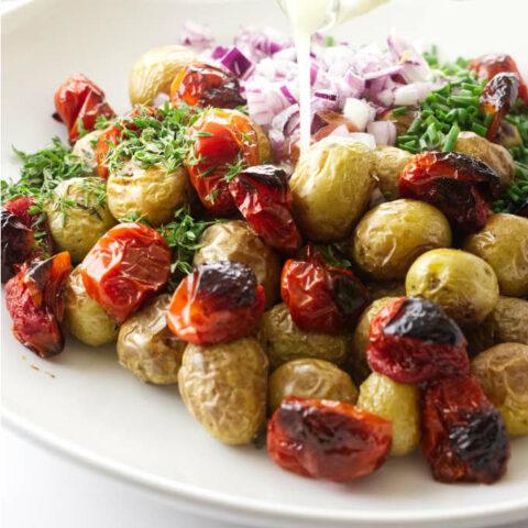 A dish with roasted potato salad.