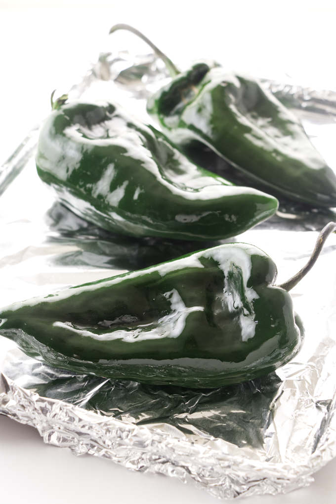 Poblano peppers on a sheet pan.