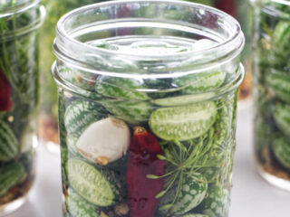 Several jars of pickled cucuamelons (Mexican sour gherkins).
