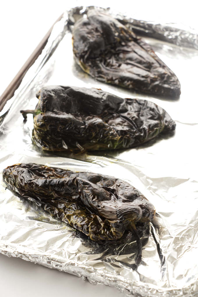 Poblano peppers on a baking sheet.