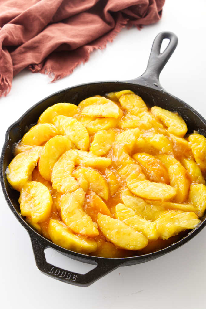 Sliced peaches in a skillet