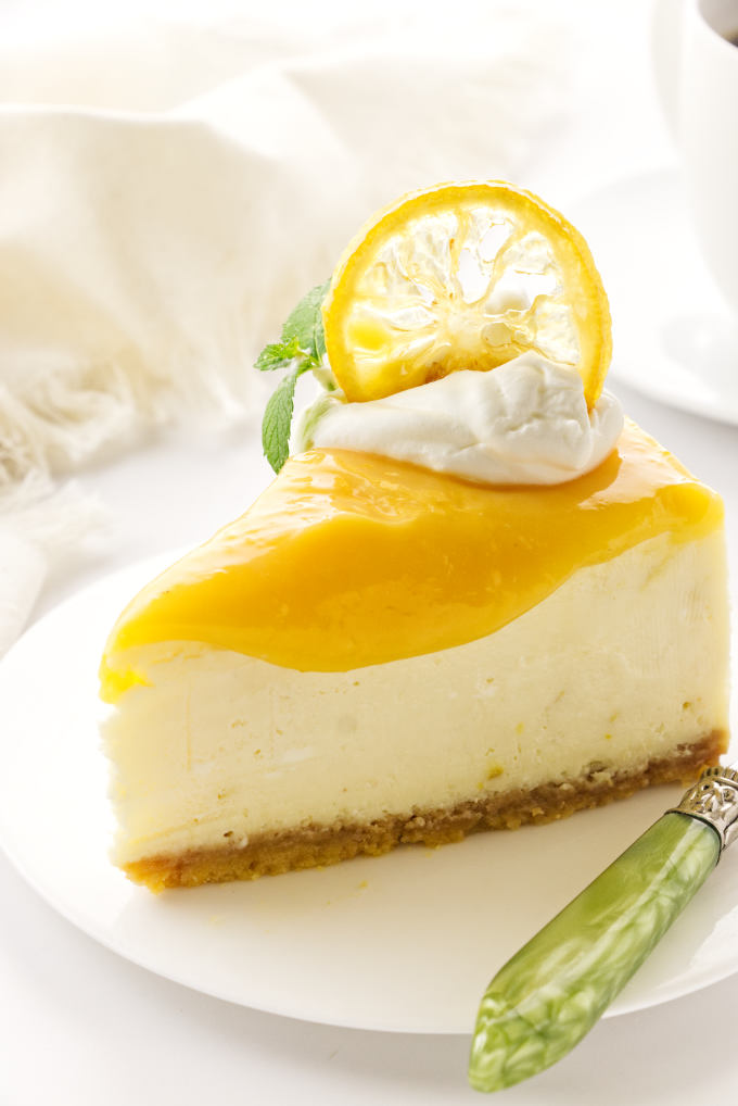 a serving of triple lemon cheesecake on a plate with green fork