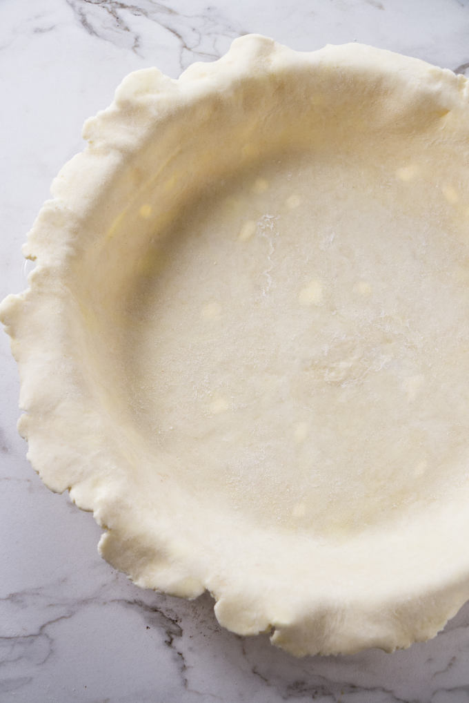 An all butter pie crust formed into a pie shell.