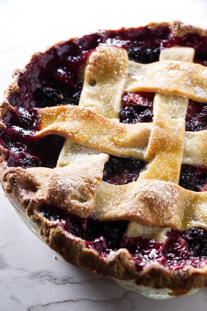 Blackberry peach pie with a lattice top.