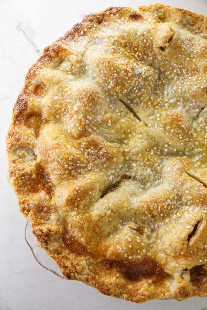 Freshly baked peach pie with sugar topped crust.