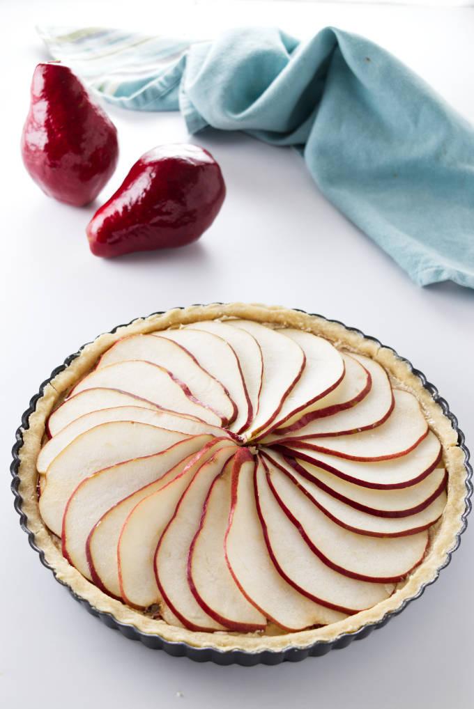A pear tart in a tart pan.